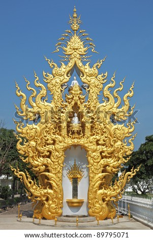 A free-standing chapel with statues of Buddha. The chapel is richly decorated and gilded in the style of the new Thai architecture