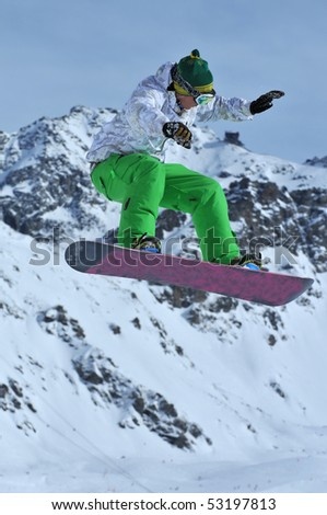 a freestyle snowboarder performing a jump