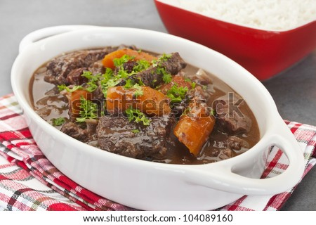 A French stew, daube of beef Provencal has a delicious sauce made from red wine, stock, cinnamon, cloves, orange and herbs. Here it is served with rice.