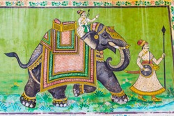 A fresco of an elephant and two Rajput warriors on a wall in Jodhpur, India.