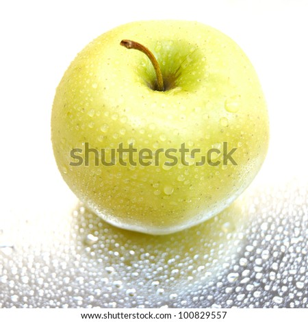 a fresh apple with water droplets