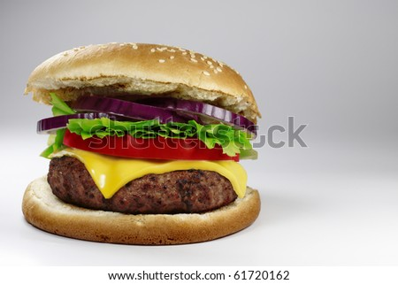A fresh cheeseburger on gray background.