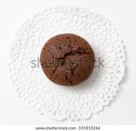 a fresh chocolate muffin (cake), top view