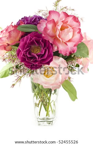 A fresh cut bouquet of colorful spring roses from a home garden, vertical with white background and copy space