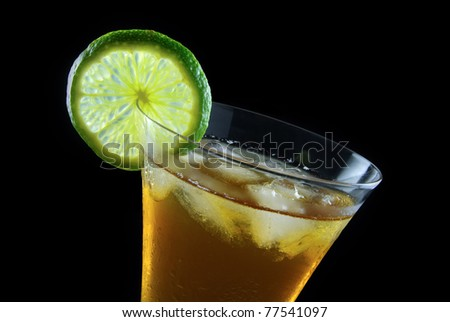 A fresh drink with a slice of lime