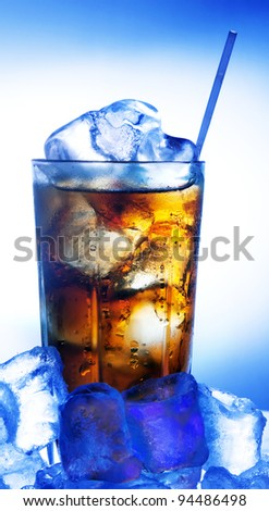 A fresh glass of cola with ice. Blue cold tone