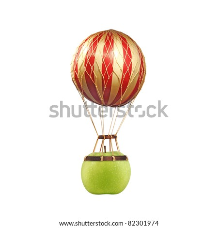 A fresh green apple tied to an exotic stripe balloon for air lifting, isolated against white.