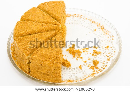 a fresh honey cake - half of pieces are missing