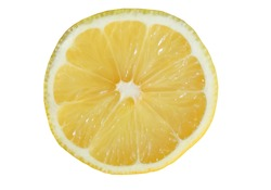 A fresh lemon cut in half isolated on white background