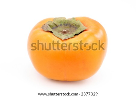 A fresh ripe persimmon, isolated on white.