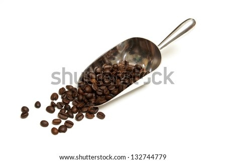 A fresh scoop of gourmet coffee beans isolated on white.