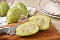 A fresh sliced cactus pear on a cutting board