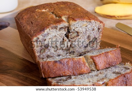 A freshly baked loaf of banana bread with walnuts.