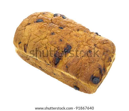 A freshly baked raisin bread loaf on a white background.