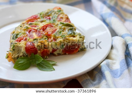 A freshly baked slice of frittata on a plate