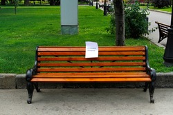A freshly painted bench in the park with a caution sign  (translated from the Russian
