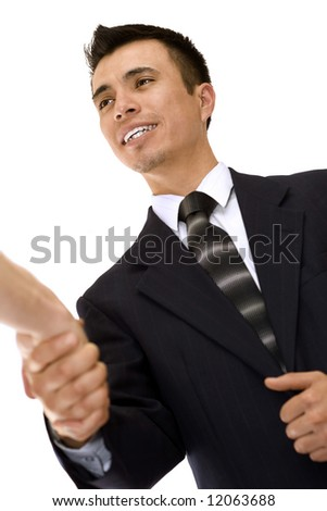 A friendly businessman shaking a hand. - stock photo