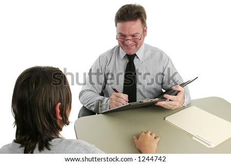 A friendly guidance counselor talking to a teen.