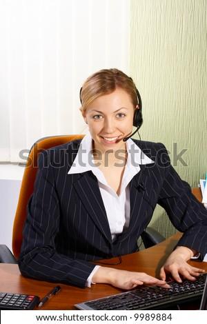 A friendly secretary/telephone operator in an office
