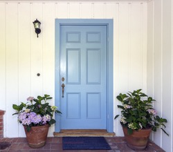 A front entrance of a home with a blue door, Blue front door wit