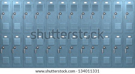 A front on view of a stack of blue metal school lockers with combination locks and doors shut on an isolated background