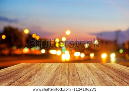 A front selective focus picture of wooden floor and blurred traffic light background  #1124186291