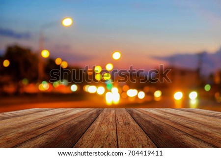 A front selective focus picture of wooden floor and blurred traffic light background  #704419411