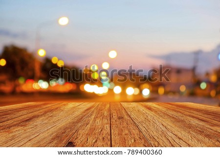 A front selective focus picture of wooden floor and blurred traffic light background #789400360