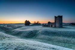 A frosty dawn over the old church at Knowlton near Wimborne in the Dorset countryside