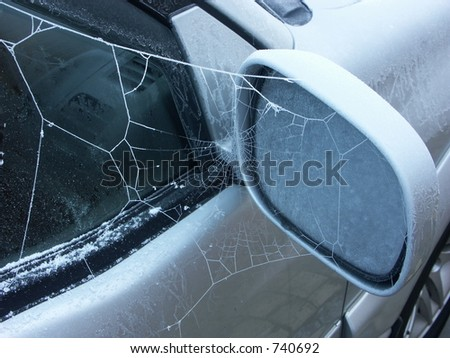 a frosty spider web on my car door this morning
