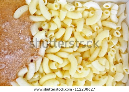 A frozen hamburger cheese and macaroni TV dinner.