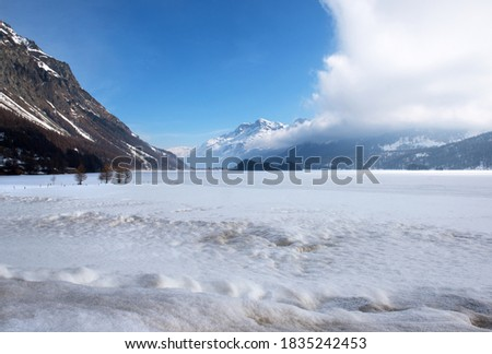A frozen Lake Sils (Silsersee) in the Engadin Valley, in Switzerland