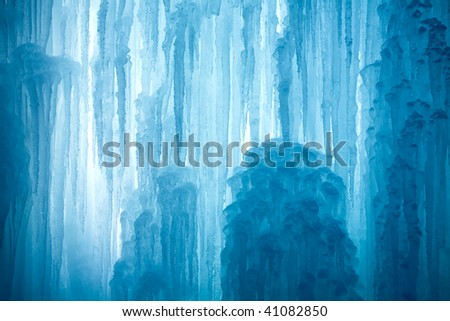 A frozen waterfall with ice in a blue and white color in winter #41082850