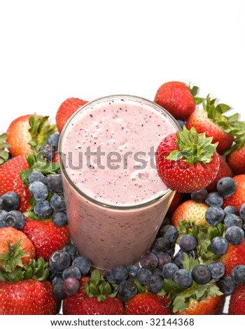 A fruit smoothie drink made of banana, blueberries, strawberries, etc. surrounded by fresh fruit