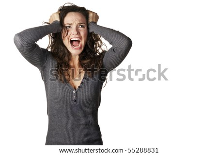 A frustrated and angry woman is screaming out loud and pulling her hair. #55288831