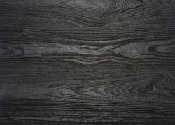 a full frame black wood grain surface