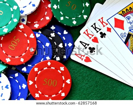 A full house poker hand cards & chips on a green felt table background - stock photo