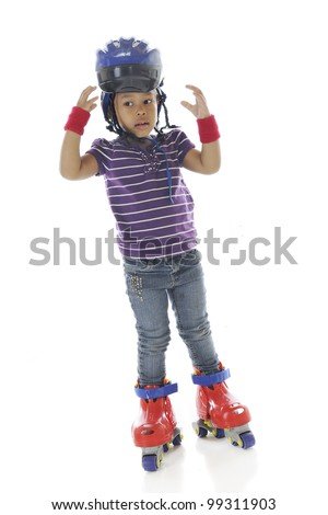 A full-length image of a preschooler looking concerned about her helmet as she stands in toy roller blades.  On a white background.