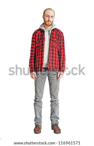 A full length portrait of a bearded  man isolated on a white background
