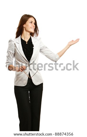 A full-length portrait of a businesswoman displaying with her arm, isolated on white background