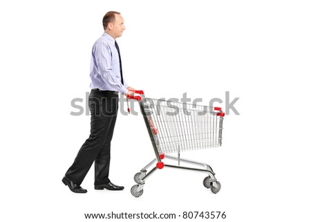 A full length portrait of a man pushing an empty shopping cart isolated on white background