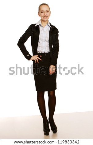 A full-length portrait of a successful businesswoman, isolated on white background