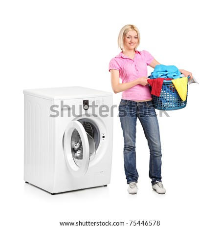 A full length portrait of a woman carrying a laundry basket and washing machine isolated on white background
