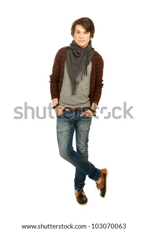 A full-length portrait of a young guy , isolated on white background