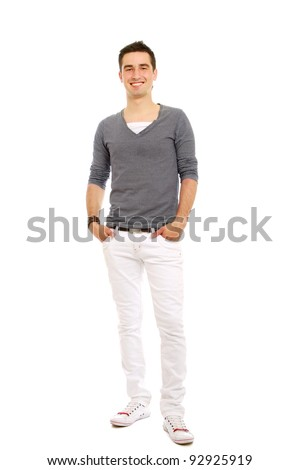 A full-length portrait of a young handsome guy holding hands on pocket, isolated on white background