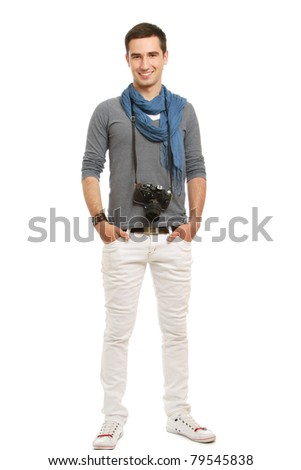 A full-length portrait of a young photographer with a camera, isolated on white
