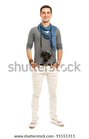 A full-length portrait of a young photographer with a camera, isolated on white background
