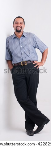 A full length portrait of an Indian man - studio