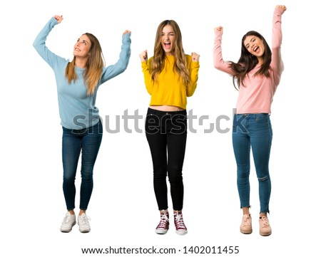 A full-length shot of a group of people with colorful clothes celebrating a victory in winner position on isolated white background on isolated white background #1402011455