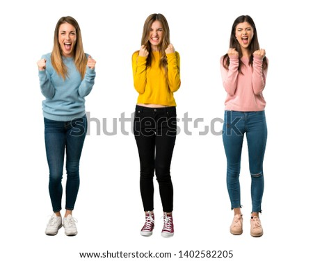 A full-length shot of a group of people with colorful clothes frustrated by a bad situation on isolated white background on isolated white background #1402582205